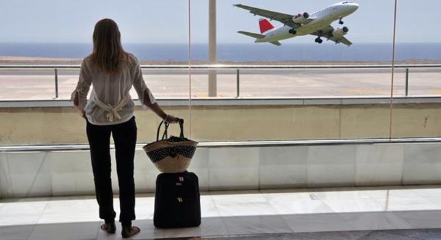 avión viaje pasajera